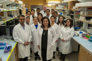Lisa Rohan (center) with group of lab associates